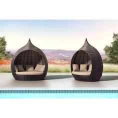 Cool outdoor seating... teardrop shaped wicker daybed with built-in canopy.