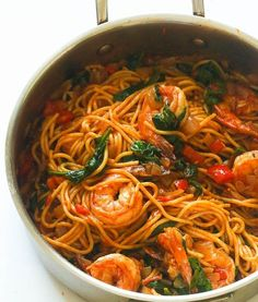 Spicy shrimp tomato spinach pasta Spicy Shrimp Spinach Pasta - an easy weeknight spinach spaghetti dinner that delivers a huge punch of flavor with no cream and just a handful of ingredients. Spicy, creamy, loaded pasta dinner that everyone would love! Spicy Shrimp Pasta, Shrimp Pasta Recipes, Seafood Recipes, Gourmet Recipes, Vegetarian Recipes, Dinner Recipes, Cooking Recipes, Healthy Recipes, Pasta Food
