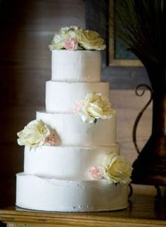 Gorgeous Flower Adornment Upon A Simple Tiered Cake From The Cupcake Shoppe