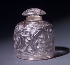 """R. LALIQUE Perfume bottle, """"Epines Flacon No. 4,"""" c. 1920, in clear and frosted glass with grey patina. Engraved R. Lalique France. M p. 343..."""