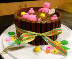 Pigs in the mud playing tennis Kit Kat cake.  Dessert.  Birthday party. Celebration.