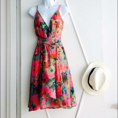 DIANEvonFURSTENBERG Summer Wrap Dress The Multi-Color dress is a classic wrap style. In the prints of the season, it pairs perfectly with strappy heels for a playful spring or summer look. True wrap style. Falls to above the knee. Fit is true to size. Diane von Furstenberg Dresses Midi