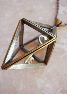 Gold Trapped Key Pendant Suspended Triangle & ...