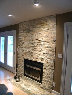 Love this stone veneer fireplace!