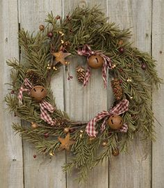 Primitive Decor Wreath- made with real pine, pine cones, rusted metal stars, fabric ties, and bells. Very easy!!