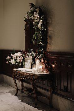 texas wedding; winter wedding; james moes; driskill hotel; black tie reception; moody winter reception; romantic winter reception; candlelit welcome table; moody winter florals;