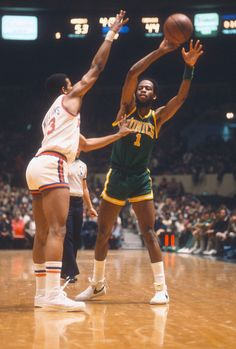 Gus Williams of the Seattle Supersonics looks to pass the ball by Ray Williams of the New York Knicks during an NBA basketball game circa 1978 at...
