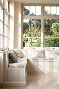 The banquette and windows make this the perfect, cozy little nook! Find other home design and interior decorating ideas, tips and inspiration on my blog: http://www.inspiredtostyle.com
