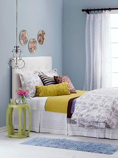 bedroom w/pale blue walls and lime green accents