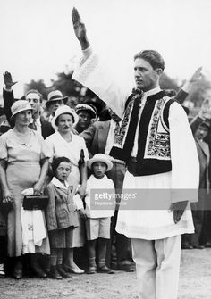 In Traditional Dress, Corneliu Zelea Codreanu Salutes The Romanian People With The Nazi Salute, Between 1930 And Get premium, high resolution news photos at Getty Images Romania People, Still Image, Traditional Dresses, World War, The Man, Black And White, Couple Photos, Ww2, Anatomy