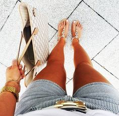 Blue/white stripped shorts, Hermes white belt, embellished sandals, gold watch, Louis Vuitton Neverfull bag