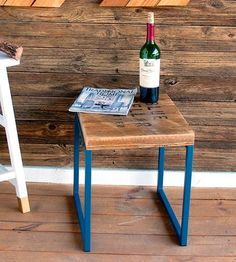 Add a rustic touch to your living space with this reclaimed wood end table. Repurposed cedar planks are pieced into the rectangular table top, lightly sanded and sealed to preserve the marks and wear in the aged wood. The end table's perched on geometric blue metal legs and sized to fit into corners, next to a sofa or by the bed to hold all of your drinks and décor.