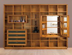 Italian designer modular wall unit and bookcase system handmade in Cherrywood. Featuring a bar unit with mirrored back and chest of drawers. Gio uses shapes and colors in modules to create innovative wall unit solutions, any space you imagine is yours to create. The collection is available in more than 31 lacquered colors or wood finishes. Made in Italy.