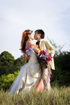 Anya's rainbow wedding dress and ribbon veil | Offbeat Bride