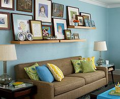 I just love this punchy yet comfortable living room. So much of the stuff (the color of both the wall and the sofa, for example) reminds me of our existing decorations!