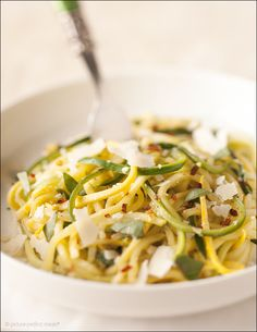 """Veggie Spaghetti - a colorful tangle of julienned zucchini and squash """"pasta"""" in a simple, delicious sauce."""