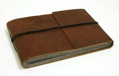 This leather photo album is handmade in India, by students of a school for disabled people.