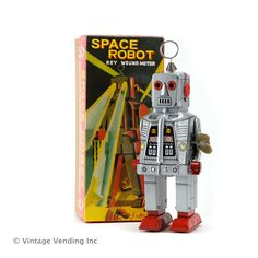 Sparking Space Robots Wind Up Tin Toys RetroPlanet.com