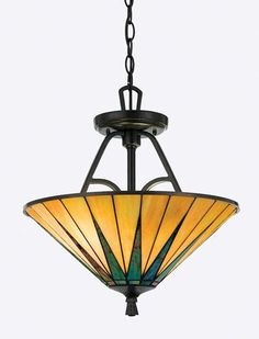 Gotham Hanging Lamp The hand-cut, iridescent art glass of this Quoizel hanging lamp is arranged to form a slender triangle pattern in shade...