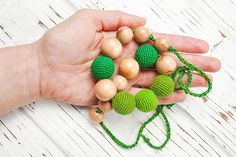 Items similar to Nursing necklace Teething necklace Baby nursing toy Necklace for mom Juniper Wood Organic cotton Green Crochet on Etsy Nursing Necklace, Teething Necklace, Beaded Bracelets, Toy, Trending Outfits, Unique Jewelry, Classic, Handmade Gifts, Earrings