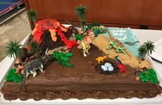 Carter's 5th Birthday- DIY Dinosaur Cake! Sheet cake from Costco, Rice Krispie treat volcano, chocolate sprinkles, Grahm cracker sand, candy rocks and boulders from winco bulk bin, fake trees from amazon. Fun & easy! Dinosaur Cake Easy, Dinosaur Cupcakes, Dino Cake, Dinosaur Birthday Cakes, Dinosaur Party, Birthday Sheet Cakes, Diy Birthday Cake, 5th Birthday, Birthday Ideas