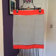 Orange with black stripes skirt I'm 5'5 and it fits above my knee. It's elegant and perfect to go to work with. It's brand new with tags. Size: Medium. Skirts
