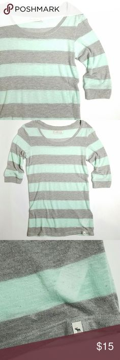 A&F • Lightweight Striped Sweater Very light and airy sweater. Gray and mint stripes. Slightly sheer. Moose logo at waist.   Good gently preloved condition with no rips, holes or stains. Does have a fair amount of pilling from material content. Can be removed with the proper tool. As is.  No holds, trades or off-posh transactions. Abercrombie & Fitch Tops Blouses