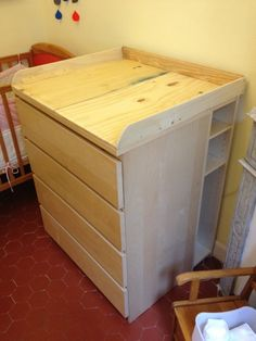 Kids Room. cream wooden Changing Table Topper on cream wooden Dresser with drawer on red floor. Pleasing Ideas Of Changing Table Topper For Dresser For Your Baby Nursery Room