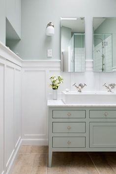 Board And Batten Bathroom. Soothing Bathroom Features Top Half Of Walls Painted Green And Lower Half Of Walls Clad In Board And Batten Lined With A Green Washstand Topped