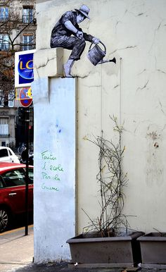 27 Playful Diversions on the Streets of Paris - street art in Paris by levalet (9)