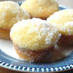 Lemon Yogurt Sugar Muffins Ingredients: 2	cups all-purpose flour  ½ cup Sugar,2½ tsp baking powder,  ½ tsp salt, ¼ cup lemon juice, preferably fresh-squeezed,¾ cup milk,  ¼ cup butter melted,1 egg beaten,  6 ounces lemon yogurt, 1 tsp. vanilla,  1 tsp. lemon zest, White sugar for rolling