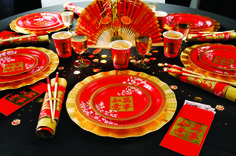 Decadent party range for a Chinese New Year party. Red and gold table decorations.