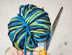Planet Earth Pom-Poms. Earth Day craft for kids.