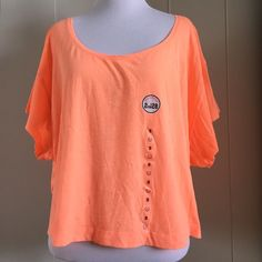 NWT neon orange top This top has a very slouchy feel. May be worn off one shoulder, low on both shoulders. Arm holes are large, neckline is very low. Front is shorter than back. Super cute top to throw on over bikinis for picnics and beach days. Perfect color for summer adventures ☀️ PINK Victoria's Secret Tops Crop Tops