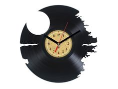 Vinyl Clock - Death Star. Upcycling product made from vinyl records. Cool gift ideas for music lovers. by TheVinylEatersShop on Etsy https://www.etsy.com/listing/222119470/vinyl-clock-death-star-upcycling-product