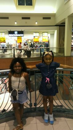 Cute cousins hanging out  at the mall food court