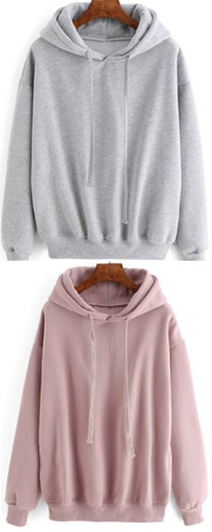 Hooded Drawstring Sweatshirt for women at ROMWE .This loose sweatshirt has grey &pink colors .Truely nice choice for a layer outfit in the fall & winter.
