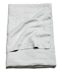 Light gray. PREMIUM QUALITY. Twin bedspread in washed linen with double-edge stitching. Tumble drying will help keep linen soft.