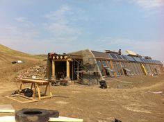 three-bedroom home with an unusual floor plan and a sweeping south-facing view toward the Little Bow River out of large glass windows. Earthship Home, France, Sustainable Architecture, Alberta Canada, Sustainable Living, Summer 2014, Square Feet, Sustainability, Pergola
