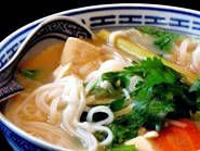 Thai Noodle soup with Lemongrass.  It can be made with chicken or tofu.  When I make it with chicken, I simply put a little olive oil, salt and pepper on chicken breasts and bake them in the oven for ~30 minutes or until the thermometer reaches 160 degrees.  Then I pull it apart and add it in at the end.