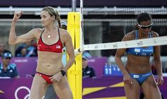 Kerri Walsh of the United States reacts after blocking the shot of Italy's Marta Menegatti, right, during a beach volleyball match at the 2012 Summer Olympics, Sunday, Aug. 5, 2012, in London.