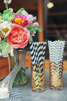Striped Wedding Table Details: Straws, cups, candy for the road, whatever it is, wrap it in stripes! And if you're wondering, chevron stripes totally count.