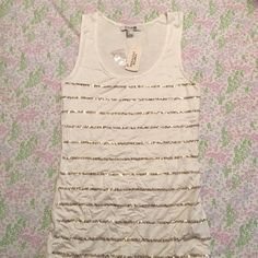 Sequined Tank Sequined with gold and white, this tank has stretch and leaves a flowy feel. Perfect under a cardigan or blazer without being too overdressed. Made with rayon and spandex, hand wash cold. Forever 21 Tops Tank Tops