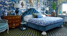 This custom-made bed in a Manhattan master bedroom is upholstered in a Schumacher velvet and dressed with Matouk linens and a Roberta Roller Rabbit quilt.