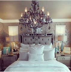 A chandelier is always a must in a glamorous bedroom.