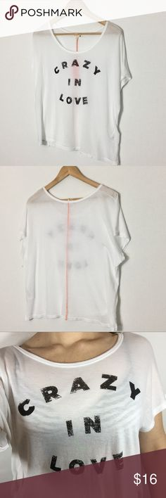 """☀️Sundry Crazy In Love Graphic Print Sheer T Shirt Brand New Never Worn with Tag.  Very Sheer White Square Tee Shirt Top.  Faded Letters (by design) spell out """"Crazy In Love"""".  There is a coral threaded line down the center of the back of the top.  Lightweight and Comfy.   Material: 50% Cotton, 50% Modal  Approximate Measurements:  Bust - 22"""" Length -20""""  Add to a bundle 😀  (A38-608-1217) Sundry Tops Tees - Short Sleeve"""