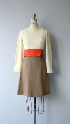 Vintage 1960s wool blend knit dress with mock collar, long sleeves, fitted waist with wide button cummerbund and back zip closure. --- M E A S U R E M E N T S ---  fits like: small bust: 33-35 waist: 27 hip: up to 37 length: 36 brand/maker: Act II condition: excellent  to ensure a good fit, please read the sizing guide: http://www.etsy.com/shop/DearGolden/policy  ✩ more vintage dresses ✩ http://www.etsy.com/shop/DearGolden?section_id=5986...