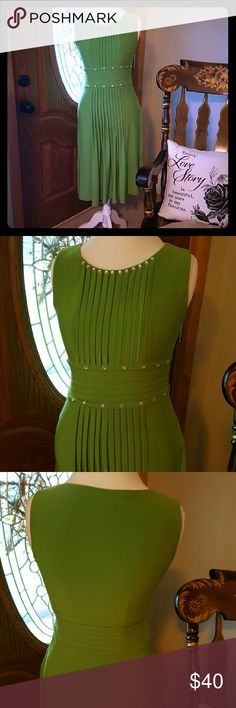 Sangria Dress Gorgeous Sangria dress, this is a real stunner! Perfect for spring/summer events! Empire waist, pleats and pin tucking with rhinestone detail around neckline abs waist.  Worn twice.  Excellent condition! Smoke free,  pet free home! Make offer! Sangria Dresses
