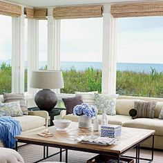 With breathtaking views of the Atlantic Ocean, this living room is an ideal spot for entertaining guests. I like how the blinds are located Coastal Cottage, Coastal Homes, Coastal Style, Coastal Decor, Seaside Decor, Porches, Living Area, Living Spaces, Living Rooms