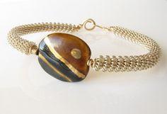 Silver coil bracelet Kazuri bead brown gold by DianaShyeJewelry